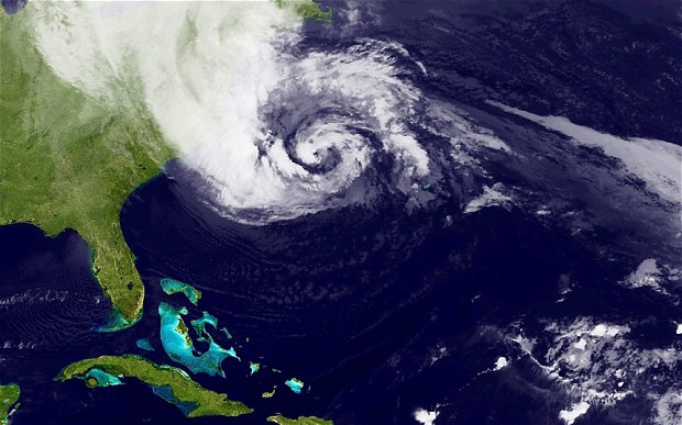 A satellite image of Hurricane Sandy, pictured at 00:15 UTC, churns off the east coast of the US Photo: NASA via Getty Images