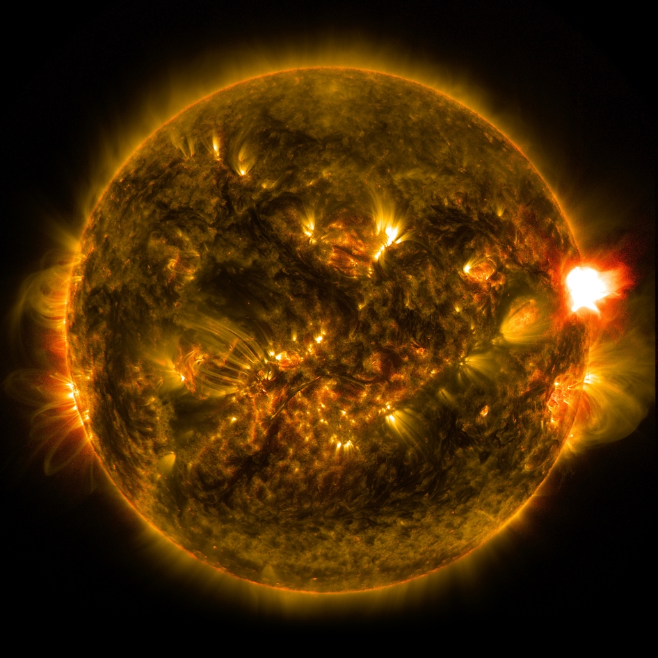 An M-class solar flare erupts from the right side of the sun in this image from shortly before midnight EST on Jan. 12, 2015. The image blends two wavelengths of light -- 171 and 304 angstroms -- as captured by NASA's Solar Dynamics Observatory. Image Credit: NASA/SDO